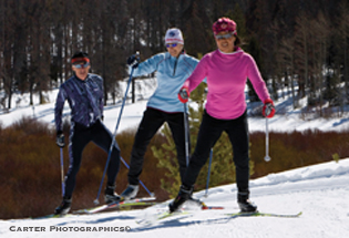 skate skiers at a Nordic Center